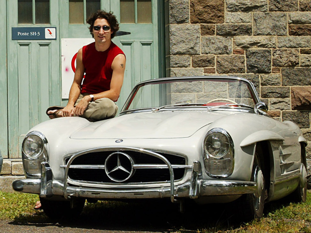 FREELANCE PHOTO: CHECK WITH NATIONAL POST FOR RIGHTS INFORMATION REGARDING THIS IMAGE DIGITAL--Jake Richler(L) sits on the new 2003 500SL Mercedes in Montreal on July 15, 2002 while Justin Trudeau still drives a 1960 300SL. For story by Richler. Life. Code 13. (Christinne Muschi/ The National Post).