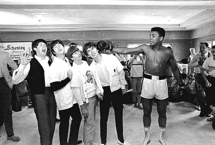 FILE - In this Feb. 18, 1964 file photo, Cassius Clay poses with The Beatles, from left, Paul McCartney, John Lennon, Ringo Starr and George Harrison, while visiting the heavyweight boxing contender at his training camp in Miami Beach, Fla. Fifty years ago, these future legends met through a chance of publicity matchmaking. (AP Photo)