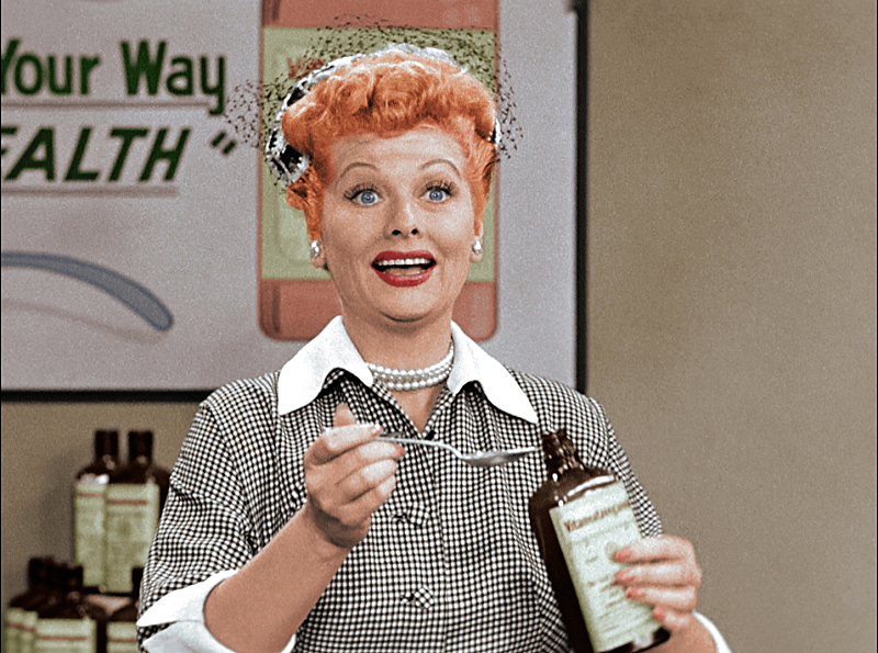 """ILucy Ricardo (Lucille Ball) takes a sip of """"Vitameatavegamin"""" from """"Lucy"""