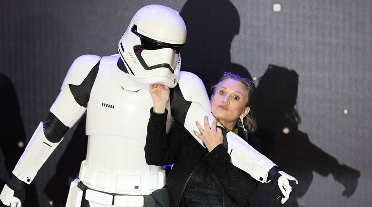 "FILE PHOTO: Carrie Fisher poses for cameras as she arrives at the European Premiere of ""Star Wars, The Force Awakens"" in Leicester Square, London, December 16, 2015. REUTERS/Paul Hackett/File Photo"